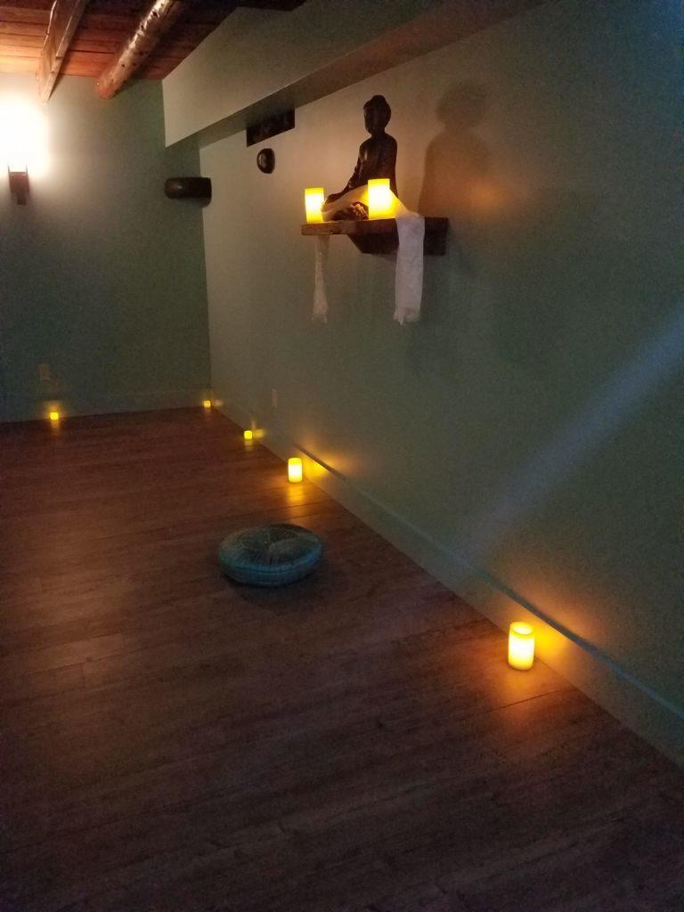 Calming, candlelit yoga studio